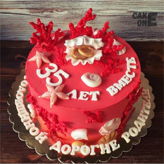 Торт с обручальными кольцами в раковине