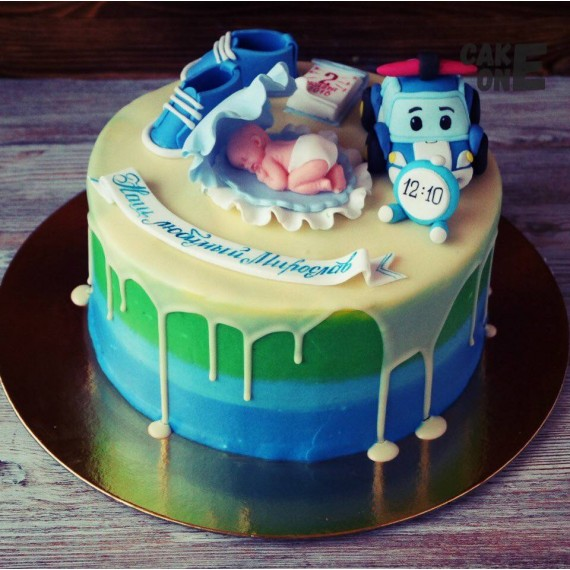 Торт-метрика с младенцем в голубой ракушке